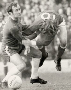 Chopper Harris shakes hands with Stan Bowles after the game